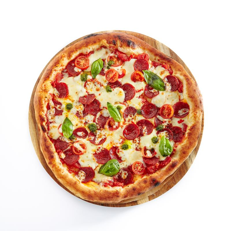 Pepperoni or Diabola Pizza with Salami, Chili Pepper Isolated on stock photography