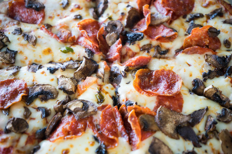 Pepperoni And Mushroom Pizza royalty free stock image