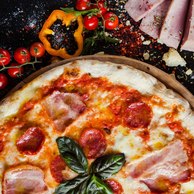 Pepperoni pizza fattening meat meal. Pepperoni pizza. Fattening and delicious meal with lots of meat stock image