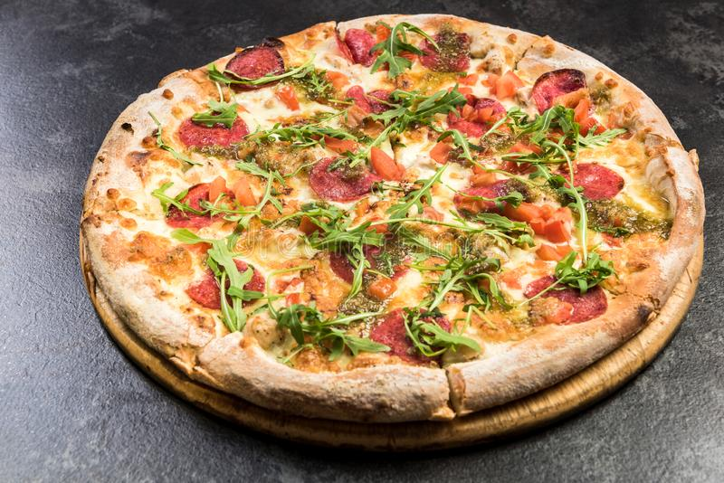 Pepperoni pizza with fresh arugula royalty free stock images
