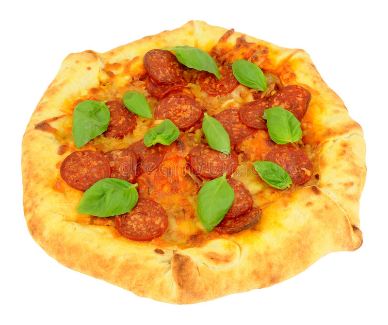Pepperoni Pizza With Fresh Basil Herb Leaves royalty free stock photo
