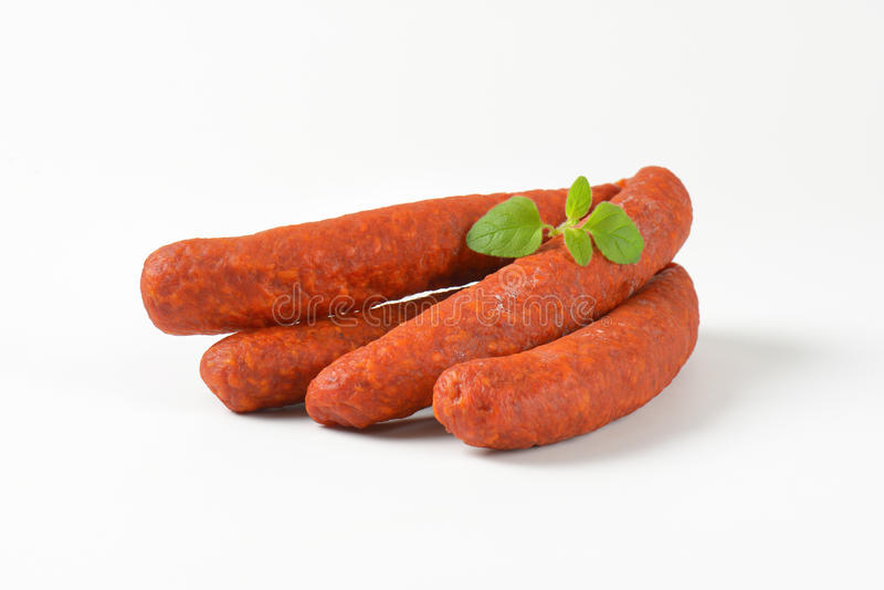 Pepperoni sausages. Four pepperoni sausages on white background royalty free stock image