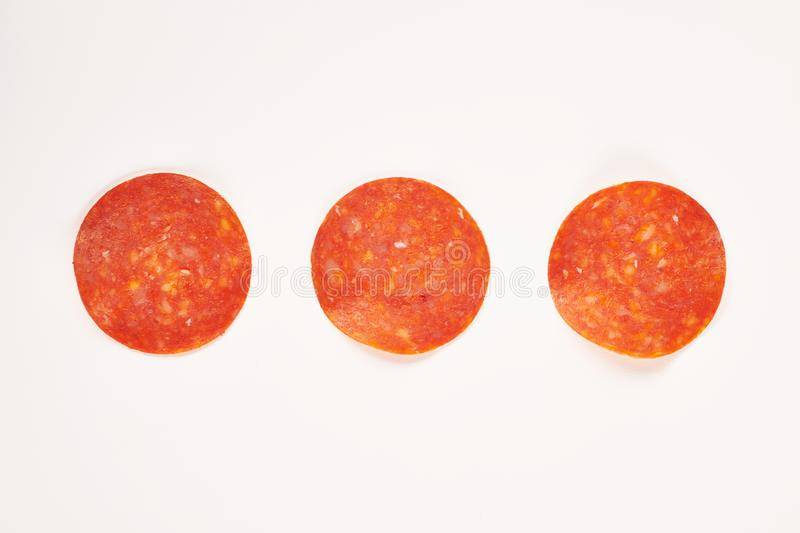 Pepperoni slices. Ingredients for pizza. Sausage. royalty free stock photography
