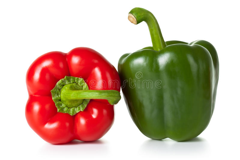 Peppers. Fresh paprika (pepper) vegetables on white background. Red and green one stock photography