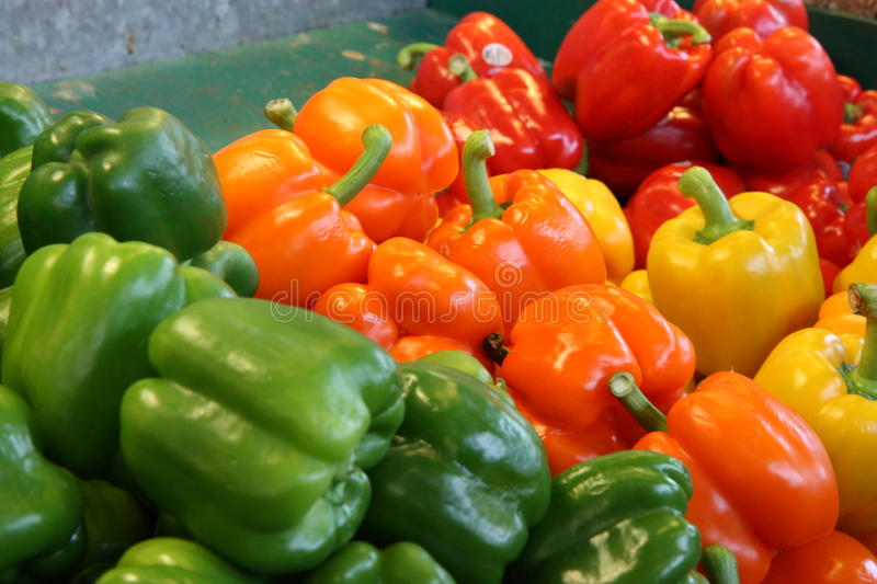 Peppers of all colors at a farmers food market royalty free stock photo