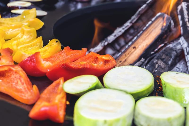 Peppers, aubergines, zucchini and kebabs on the grill on an open fire. Summer food. stock image