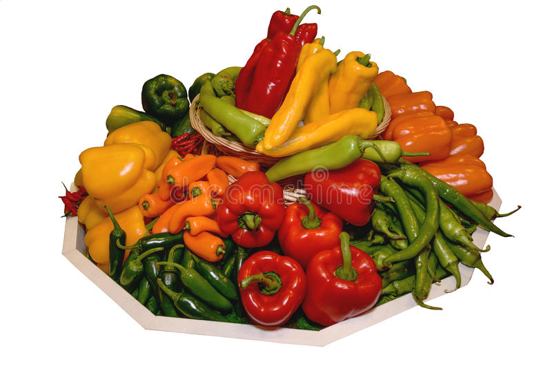 Peppers, paprika of different varieties on a large tray. Concept of healthy eating. Isolated. Vegetables on a large tray. Concept of healthy eating, abstinence stock images