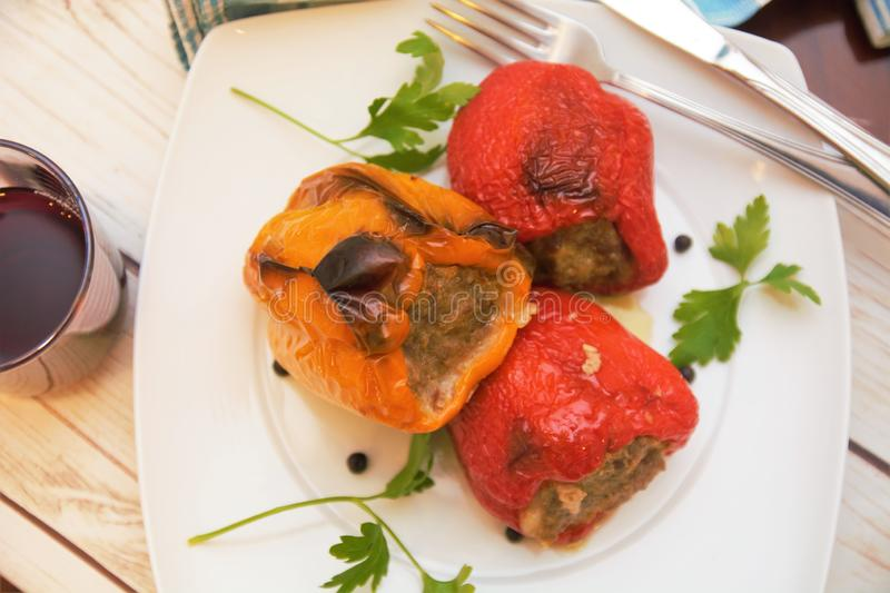 Peppers stuffed with meat italian food dish gourmet. Fork wine table restaurant nutrition vegetable royalty free stock images