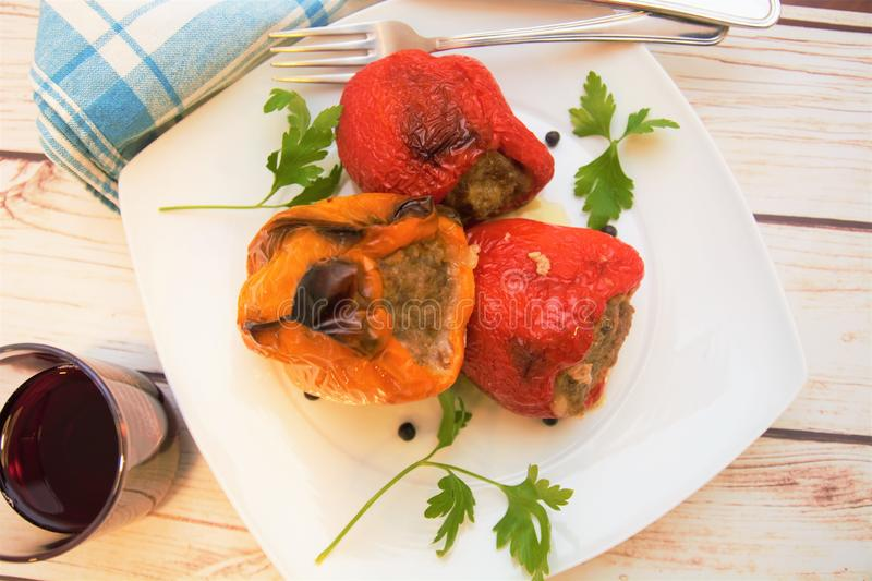 Peppers stuffed with meat italian food dish gourmet. Fork wine table restaurant nutrition vegetable stock image