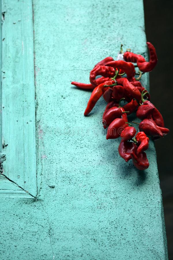Peppers in the window. Ä°n old Antioch street. They dry the peppers with natural methods. Peaceful and peaceful place royalty free stock photos