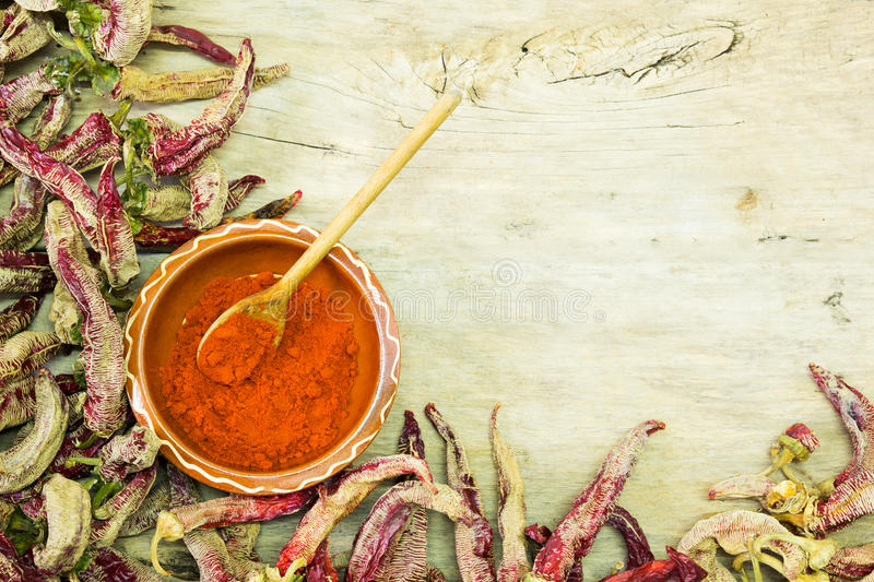 Peppers on wooden table. stock photos