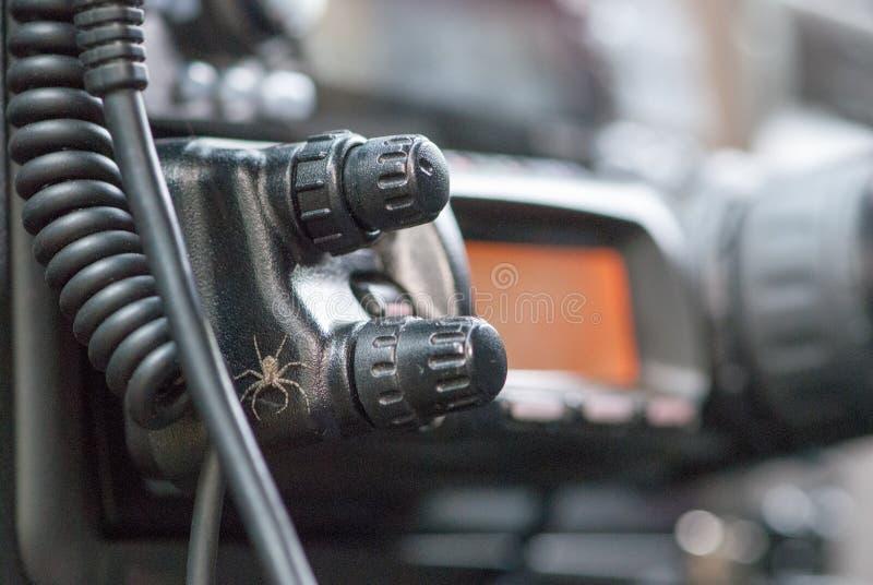 Pequeña araña en la estación de radio del aficionado de radio de coche foto de archivo libre de regalías