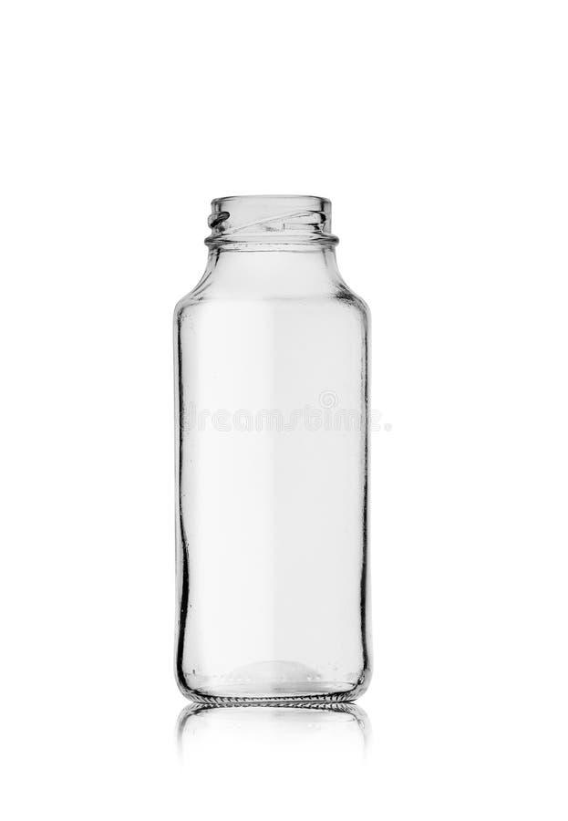 Pequeña botella vacía de cristal después del jugo foto de archivo