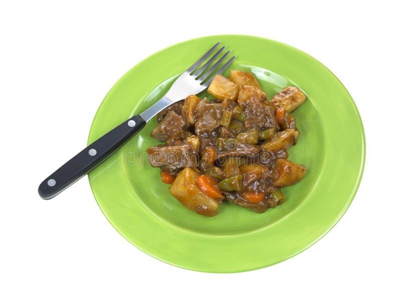 Pequeña comida de la carne de vaca de carne asada con la fork en la placa imagen de archivo