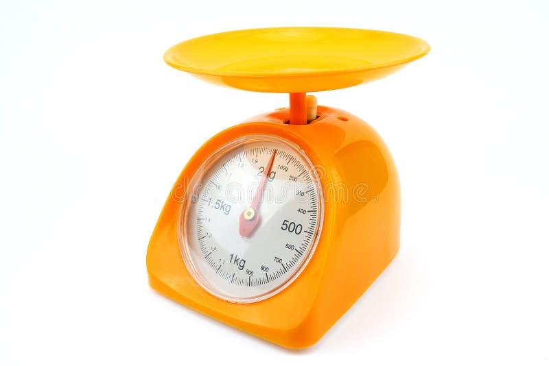 Pequeña escala amarilla del peso fotografía de archivo