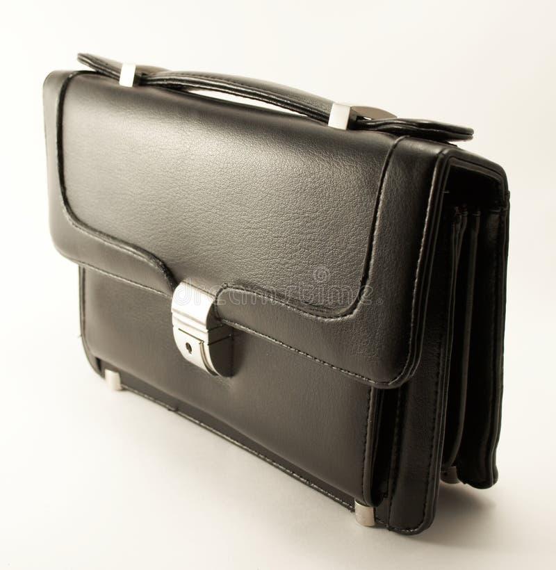 Pequeña maleta negra foto de archivo libre de regalías