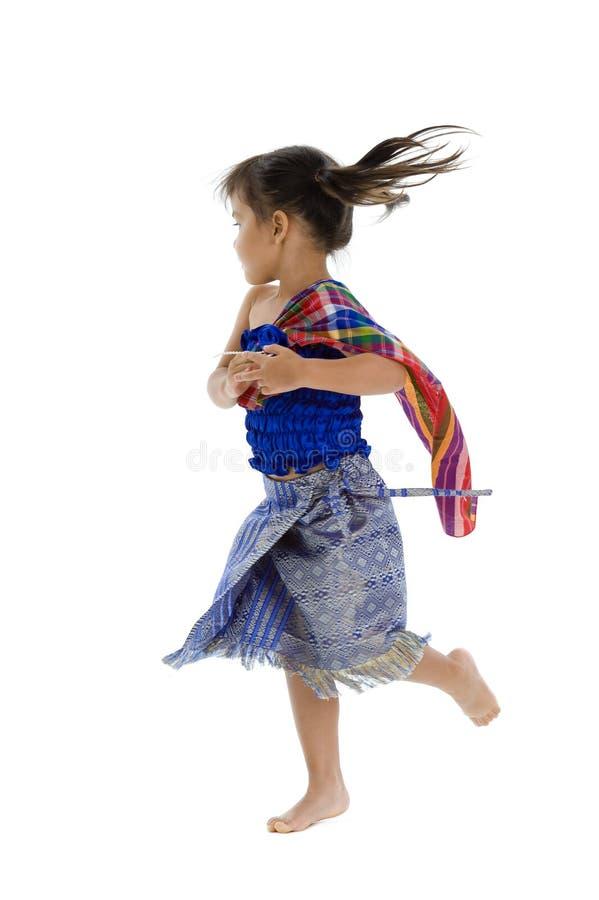 Pequeña muchacha con movimiento de la acción imagenes de archivo