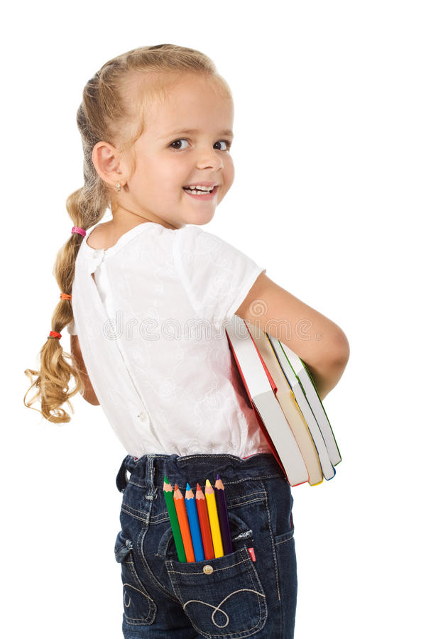 Pequeña muchacha emocionada que se prepara para volver a la escuela foto de archivo libre de regalías