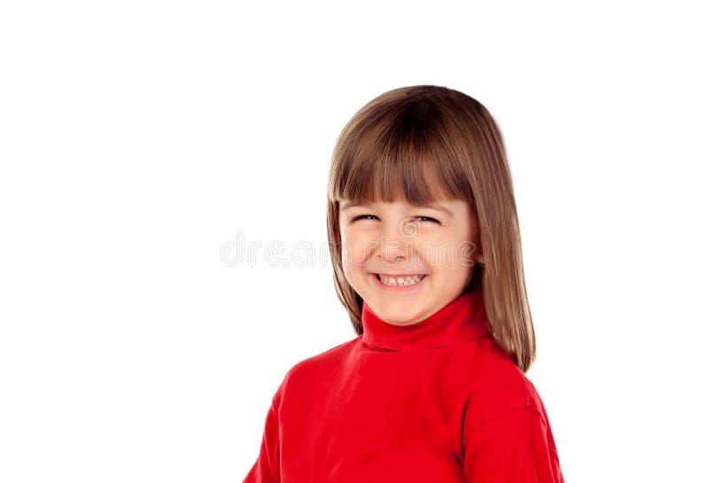 Pequeña sonrisa feliz de la muchacha fotografía de archivo