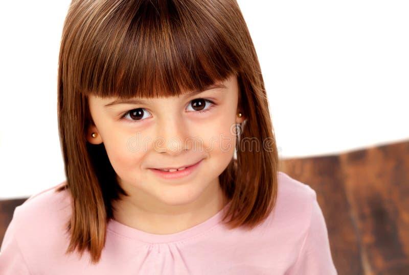 Pequeña sonrisa feliz de la muchacha foto de archivo