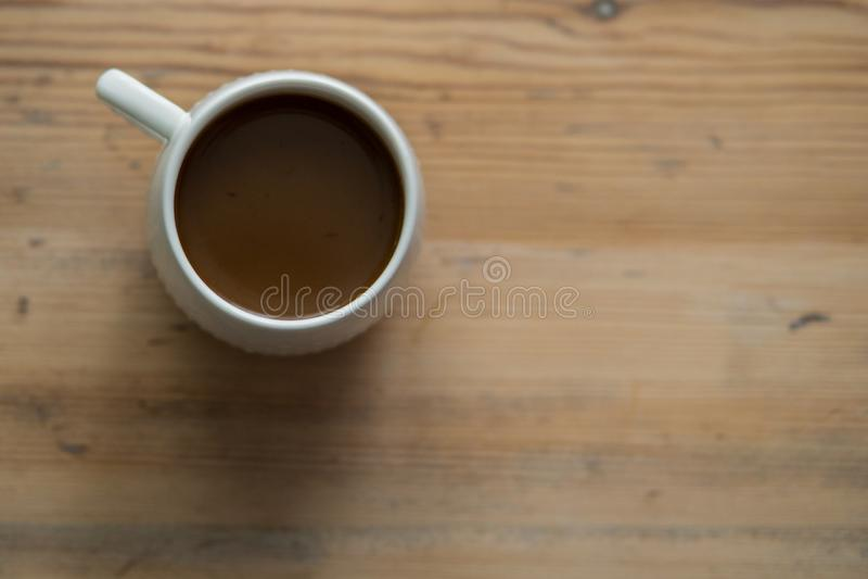 Pequeña taza de café blanca imágenes de archivo libres de regalías