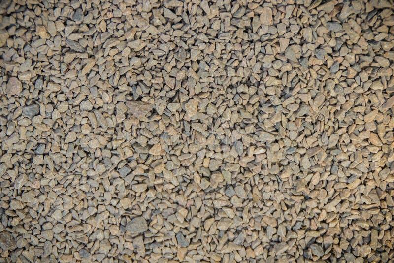 Pequeña textura de piedra del fondo de la grava Textura de la grava para el fondo Piedras machacadas en el ferrocarril para la te fotografía de archivo libre de regalías