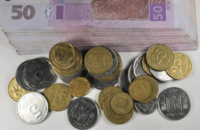 Pequeñas monedas ucranianas y billetes imágenes de archivo libres de regalías