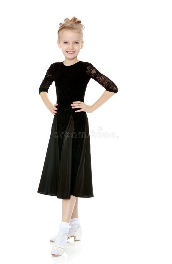 Pequeño bailarín hermoso en un vestido negro foto de archivo libre de regalías