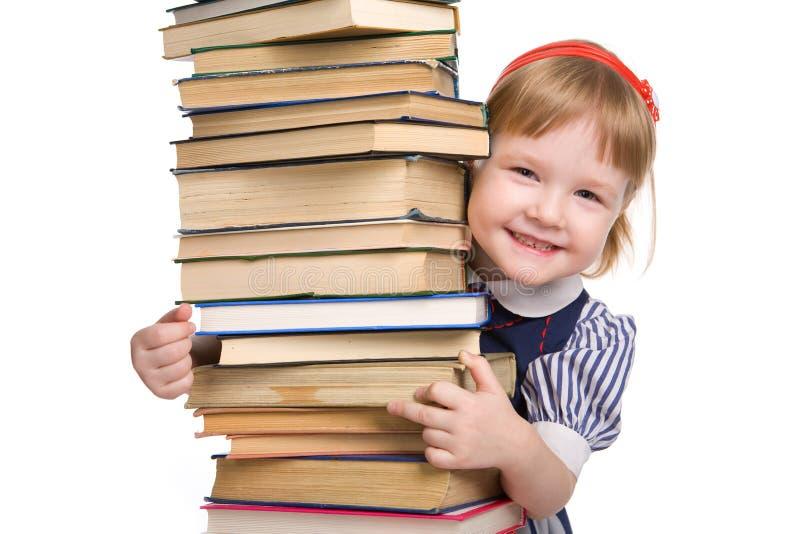 Pequeño bebé con los libros aislados foto de archivo libre de regalías