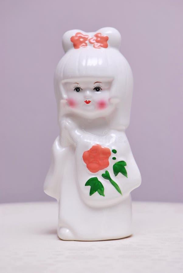 Pequeño Clay Doll imagenes de archivo