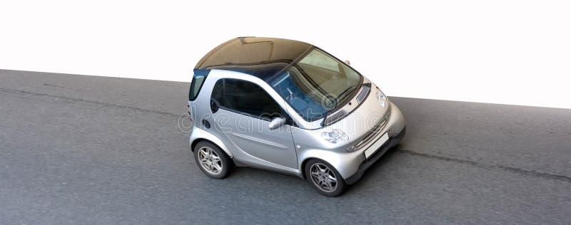 Pequeño coche elegante minúsculo aislado foto de archivo libre de regalías