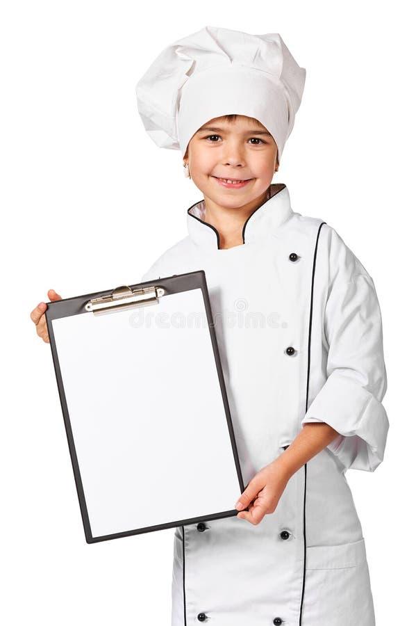 Pequeño cocinero que lleva a cabo la tarjeta en blanco del menú de los cocineros imagenes de archivo