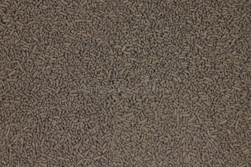 pequeño fondo marrón del catalizador de la pelotilla fotografía de archivo libre de regalías