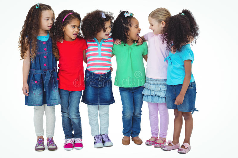 Pequeño grupo de niños que se unen fotografía de archivo