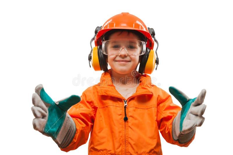Pequeño ingeniero sonriente del muchacho del niño o trabajador manual imágenes de archivo libres de regalías