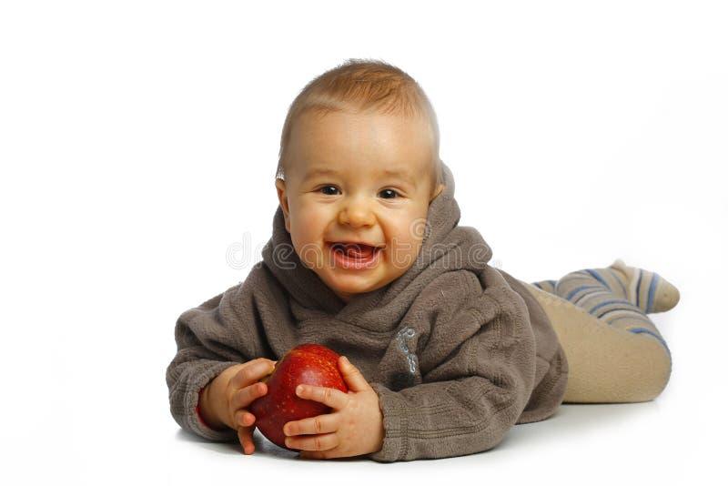 Pequeño muchacho con la manzana foto de archivo libre de regalías