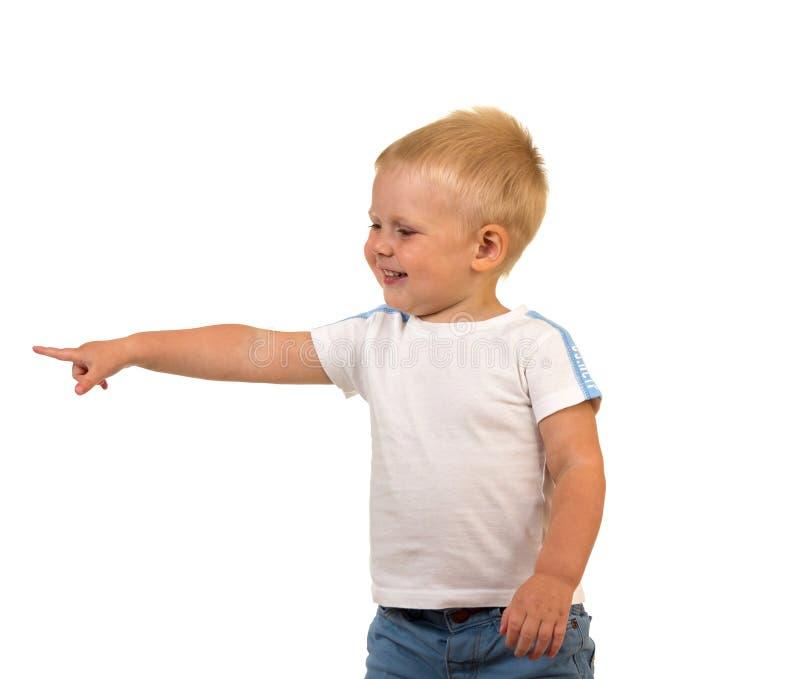 Pequeño muchacho sonriente que muestra el finger en la bandera, aislada en blanco fotografía de archivo libre de regalías