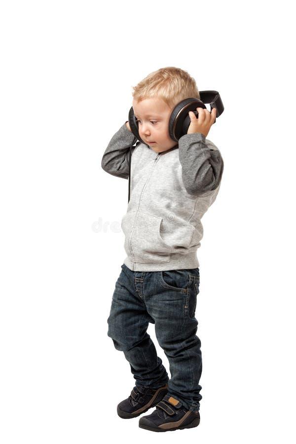 Pequeño niño con el auricular imágenes de archivo libres de regalías