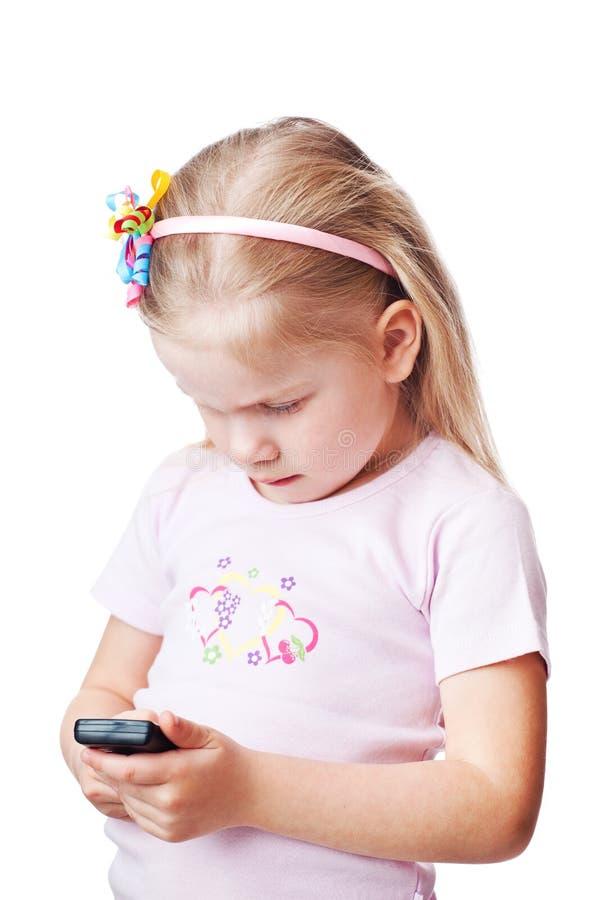 Pequeño niño con la célula fotografía de archivo