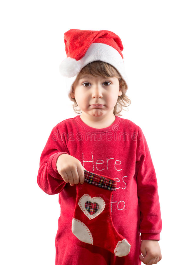Pequeño niño divertido que sostiene el calcetín vacío de la Navidad fotografía de archivo