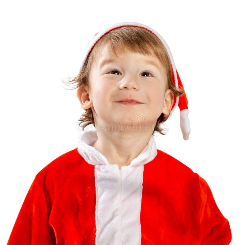 Pequeño Santa Retrato de un niño en un traje Navidad imagenes de archivo