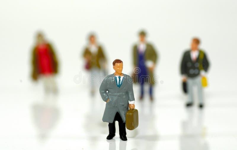 Pequeños hombres de negocios 3 imagenes de archivo
