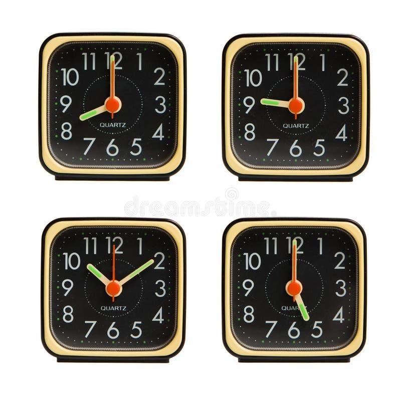 Pequeños relojes que muestran la varia época del día imágenes de archivo libres de regalías