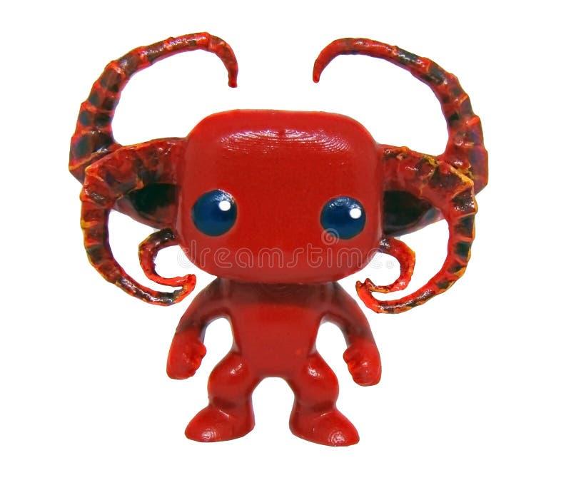 Pequena figurinha de miniatura do diabo fotografia de stock