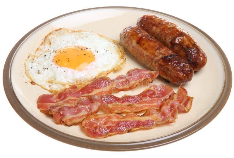 Pequeno almoço da salsicha, do bacon & do ovo fotografia de stock