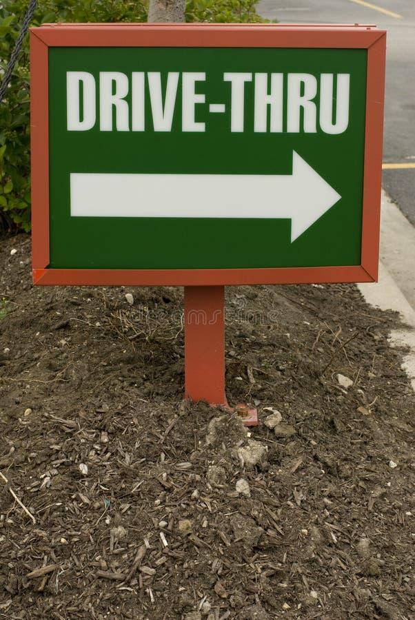 Pequeno conduzir-através do sinal fotografia de stock