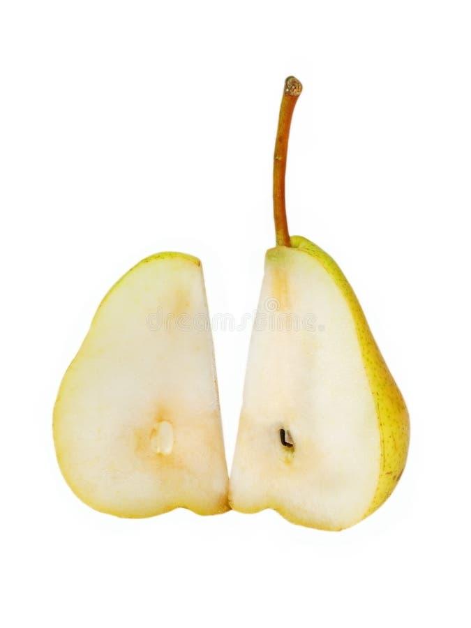 Pera amarilla madura rebanada. imagenes de archivo