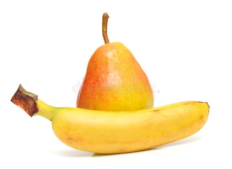 Pera y plátano foto de archivo