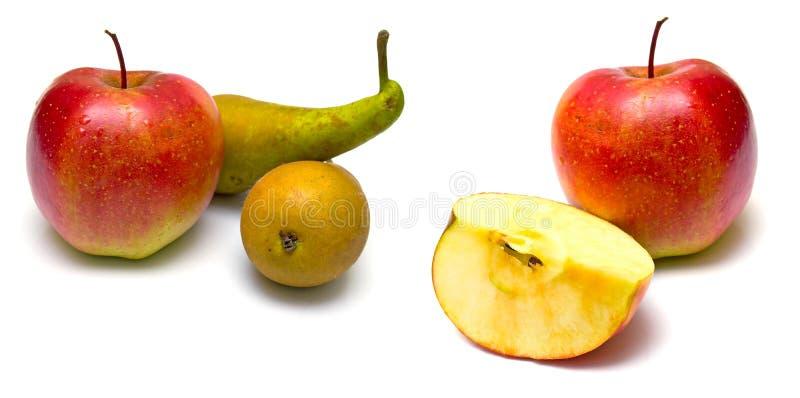 Peras verdes y manzanas rojas fotografía de archivo