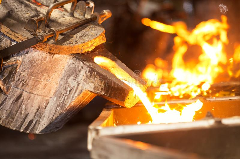perator pouring molten metal in automatic casting line in foundry factory stock image